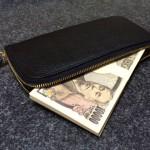 お金020(財布から覗くお札)